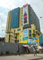 Giant billboard of coca cola on side of a mall, Addis abeba region, Addis ababa, Ethiopia (Eric Lafforgue) Tags: africa street city color building sign vertical shop retail facade mall shopping giant poster outdoors store commerce exterior capital large billboard advertisement business commercial shoppingmall huge ethiopia addisababa groupofpeople signboard development consumerism enormous hornofafrica advertise eastafrica thiopien etiopia abyssinia urbanscene ethiopie etiopa buildingexterior fulllenght addisabeba dembel  etiopija ethiopi  ethnicgroup etiopien etipia  etiyopya          addisabebaregion ethio163097