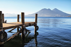 Lauch Your Dreams (Isaac Fast) Tags: lake mountains reflection water beauty landscape muelle back dangerous dock san natural guatemala windy curvy pedro atitlan roads laguna marcos mountainous solola tomilan