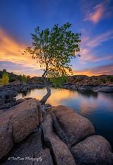 Through the Cracks (TreeRose Photography) Tags: blue sunset arizona sky orange water clouds reflections landscape scenery colorful dusk boulders granite serene prescott watsonlake fiery rockformations