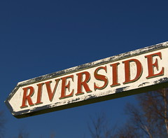 Riverside sign in Preston (Tony Worrall) Tags: uk blue england sky white cold sign metal way point photo words riverside image decay letters bluesky lancashire direction signage preston british pathway prestonian lnacs ©2012tonyworrall
