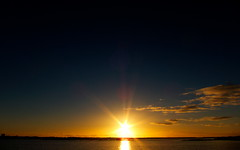 10/10/10 Sunset 3 (tobysx70) Tags: ocean sunset sea toby reflection portugal water clouds digital canon de faro gold october 10 powershot atlantic algarve hancock ilha 2010 s90 ilhadefaro 101010 canonpowershots90 canons90 tobyhancock