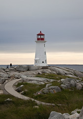 The Road to Guidance. (chris_starscream) Tags: ocean travel lighthouse canada heritage tourism water grass stone canon rocks waves novascotia cloudy path cove ships sightseeing shoreline overcast roadtrip landmark tourist canadian historic atlantic sidewalk trail shore historical peggys peggyscove eastern navel bedrock tourisml nspp t1i shipsxwater
