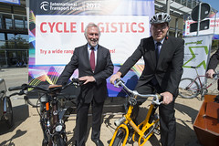 Manfred Neun and Jan Muecke pose with bicycles at the Annual Summit