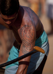Tattooed Man Ready For Canoe Competition At Anakena beach, Easter Island, Chile (Eric Lafforgue) Tags: chile shirtless color colour latinamerica southamerica vertical tattoo chili pacific muscular canoe worldheritagesite pacificocean easterisland oneperson 20s colorphoto rapanui isladepascua hangaroa midadult southpacificocean  onemanonly 5884  nativeman ili  polynesianisland midadultmen   ile    southeasternpacificocean polynesiantriangle chileanpolynesia