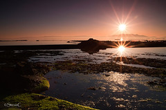 Double Sunburst (StevieC-Photography) Tags: uk sunset sea sky sun sunlight reflection nature rock outdoors photography scotland moss published tranquility nopeople lensflare dramaticsky isle scenics ayrshire beautyinnature colourimage kilmarnockstandard steviec doublesunburst