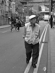 P1010841-1 Seen it all before? (Lawrence Holmes.) Tags: uk bw white black 35mm lens manchester lumix prime mono chinatown streetphotography lancashire g2 24mm nikkor ais terms 48mm candidandstreet micro43s