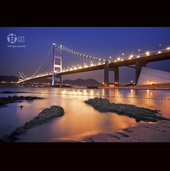 HONG KONG : Tsing Ma Bridge  (Tomatoskin) Tags: blue sunset beach buildings hongkong movement rocks landmark icon beyond bluehour mawan sigma1020mm tsingmabridge dedicate  wongkakeung curators locationhongkong  asiasworldcity lightstrail hongkongtourism canoneos40d curatorschoice tomatoskinkam