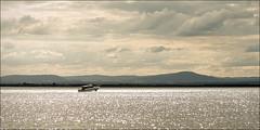 raymond-island-3770-ps-w (pw-pix) Tags: sun lake mountains water sparkles clouds boat haze cloudy australia victoria hills ripples raymondisland paynesville gippslandlakes lakeking eastgippsland