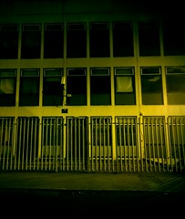 The Compound (WatermelonHenry) Tags: windows building green window metal night fence manchester compound bars clayton security nighttime repetition blinds metalbars