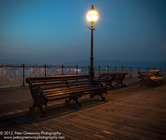 Illuminated Lamp Post And Benches On Swanage Pier (Peter Greenway) Tags: lowlight victorian lamppost benches swanage jurassiccoast lookingouttosea victorianpier theoldpier