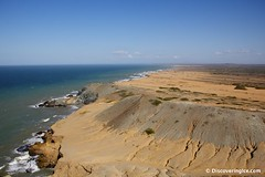 Views of the Colombian coastline and the country's first wind farm in the distance at Cabo de la Vela (Discovering Ice) Tags: travel southamerica colombia desert travelphotography cabodelavela indigenoustribe wayuu laguajira discoveringice