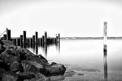Pier in black and white [Explored] (HenrikHansen) Tags: longexposure blackandwhite bw seascape nature water landscape denmark pier rocks danmark jutland jylland the4elements nikond90 sottrupskov