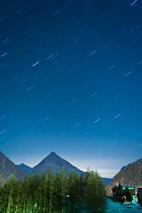 Starlit Night - Saas Fee Star Trails Plate I (Thomas Sittler) Tags: blue cloud house mountain tree green night stars delete5 star delete2 delete6 delete7 save3 delete3 delete delete4 save save2 trail save4 save5 saasfee startrail deletedbythedeletemeuncensoredgroup