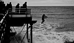 Leap (LewiBennett) Tags: sea bw seascape beach canon coast pier seaside jumping waves surfer north off front line east saltburn sigma70300mm 40d