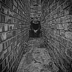 A rock and a hard place (martinfowlie) Tags: blackandwhite man building texture canon point alone bricks sigma tunnel squat jacket 7d hood vanishing loner 2012 lotsofthem week24 sistersofmercy rockandahardplace 522012 52weeksthe2012edition weekofjune10