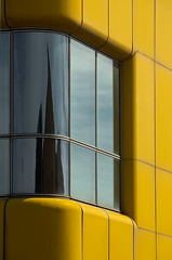 Window on a yellow rounded corner (legoland) (sandroraffini) Tags: urban lines reflections details curves bologna minimalism legoland distortions flickrduel