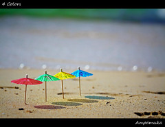4 Colors /  (AmpamukA) Tags: travel blue red sea color cute green beach yellow umbrella four kid sand bokeh small 4 mini row line cocktail tiny      ampamuka