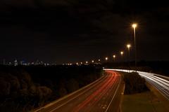 DSC_1024 - Eastern (Derek Midgley) Tags: city skyline dark lights evening long exposure bright melbourne headlights freeway eastern taillights nikond7000