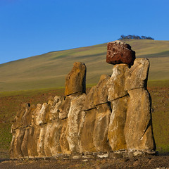 Monolithic Moai Statues At Ahu Tongariki, Easter Island, Chile (Eric Lafforgue) Tags: chile travel colour history archaeology southamerica nature statue rock stone outdoors polynesia chili order exterior pacific guard bluesky nopeople worldheritagesite pacificocean majestic moai easterisland colorphoto rapanui isladepascua ahutongariki southpacificocean  7946 placeofinterest oldruin internationallandmark ancientcivilisation  ili  polynesianisland southamericanculture   ile    southeasternpacificocean polynesiantriangle chileanpolynesia