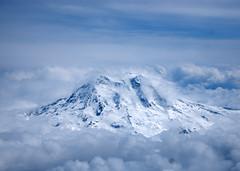 Mt. Rainier (The_real_twomartinis) Tags: seattle blue sky mountain clouds plane 35mm prime washington mt flight peak rainier d40