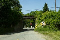 Potential for Humor (oliva732000) Tags: road railroad light summer sign rural underpass vermont afternoon low country sharon railway stop narrow embankment vt