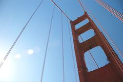 Golden Gate flare (AmyKClark!) Tags: sanfrancisco light vertical metal bridges goldengatebridge sunflare