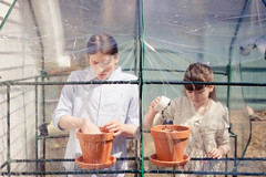 Working together (Kilkennycat) Tags: family boy portrait canon children spring child friendship gardening sister brother longhair soil greenhouse claypot pancake planting 500d kilkennycat 40mm28 t1i ryanconners nationalsiblingsday