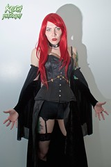 IMG_0617 (Neil Keogh Photography) Tags: blue red orange black green stockings leather female chains comic highheels boots knickers lace vampire esmee wig corset graphicnovel shorts cosplayer suspenders fangs choker caper suspenderbelt stockingssuspenders indiecomic highheeledbootstattoos salfordcomiccon2016