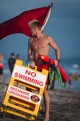 Oceanside Lifeguards (EthnoScape) Tags: ocean california red summer rescue tower beach water yellow youth danger swimming swim training athletic surf surfer lifeguard tourist rubber safety health bikini oceanside shore surfboard swimmer boardshorts fiberglass swimmers athlete fitness rookie assistance trainer fins drowning drown wetsuit baywatch lycra lifesaver riptide lifeguardtower lifeguards lifesavers touristseason neoprene swimfins ripcurrent rescuer ethnoscape cityofoceanside polyeurathane ethnoscapeimagery rescuingtube