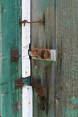 Nothing to Hide (Doris Burfind) Tags: door wood abstract texture barn lock bolt weathered hook milton peelingpaint latch blueandrust
