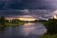 Storm Rises On A Summer Day (k009034) Tags: 500px weather copy space finland matkaniva oulainen outdoors pyhajoki bush clouds dramatic sky nature no people reflection river rural storm summer sunlight trees water teamcanon copyspace dramaticsky nopeople