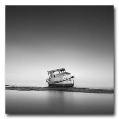 (jose.singla) Tags: light shadow bw españa white seascape black byn blanco luz water monochrome canon landscape luces spain agua barca barco negro sigma sombra minimal reflejo reflexions 18200 sombras abandonado varado 50d josesingla joseantoniogimenez
