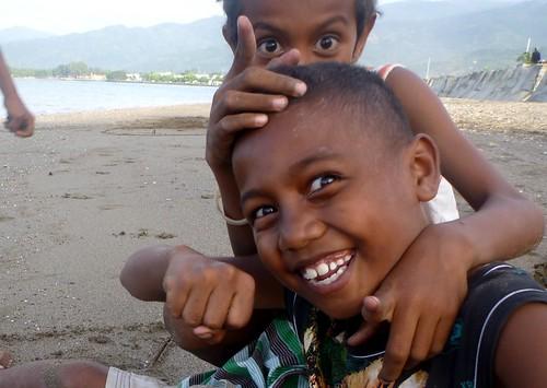 Boys play on Dili beach