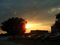 Sunset (CameliaTWU) Tags: trees sunset cars texas denton sunflare