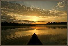 Good Morning (WanaM3) Tags: park lake reflection nature water clouds sunrise golden pond bravo texas canoe bayou pasadena canoeing paddling daybreak bayareapark supershot armandbayou flickrdiamond wanam3 sunrays5