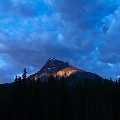 Facing off the Sun (Sarah Arquitt Photography) Tags: canada nature sunrise canon photography photo alberta banffnationalpark candianrockies rebelxs canonef1635mmf28liiusm azotaphotography