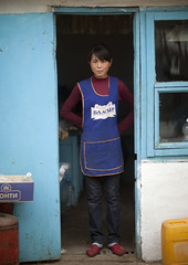 Woman With An Apron At The Entrance Of Her Restaurant, Kochkor, Kyrgyzstan (Eric Lafforgue) Tags: people woman house vertical female standing person one asia exterior fulllength entrance apron housing centralasia kyrgyzstan humanbeing oneperson colorphoto kochkor kyrgyzrepublic kirghizistan kirgistan lookingatcamera kirghizstan kirgisistan 9345 قيرغيزستان киргизия キルギスタン quirguizistão
