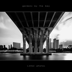 Under the Sheares (s.khai) Tags: city bridge sunset sea bw white black beach monochrome gardens by skyline sunrise river mono bay singapore long exposure cross angle sony 110 wide monotone f1 pit east nd benjamin alpha a200 tamron suntec bnw kallang tanjong rhu sheares 1650 nd110