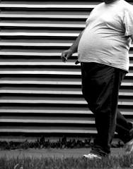 Horizontal Stripes make you look fat (CoolMcFlash) Tags: street blackandwhite bw white man black monochrome lines canon walking person photography eos fotografie stripes fat dick belly sw mann tamron schwarz plump thick gehen streifen fett bauch linien weis fav10 strase 18270 60d b008