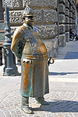 Hungary-0080 - Which way to.... (archer10 (Dennis) (66M Views)) Tags: policeman statue 1900 budapest hungary d300 nikon 18200vr 70300mmvr free freepicture archer10 dennis jarvis dennisgjarvis dennisjarvis iamcanadian cosmos tour 2012