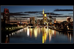 Frankfurter Skyline (Haldorfer) Tags: travel bridge sky reflection building skyline architecture night skyscraper river germany deutschland evening abend hessen nacht frankfurt urlaub main illumination himmel architektur brcke fluss allemagne spiegelung gebude germania beleuchtung reise bankenviertel hochhaus hesse wolkenkratzer bulbexposure langzeitbelichtung luminale supershot abigfave flickrdiamond mygearandme mygearandmepremium mygearandmebronze mygearandmesilver mygearandmegold mygearandmeplatinum mygearandmediamond haldorfer bestofblinkwinners jrgenkrug rememberthatmomentlevel4 rememberthatmomentlevel1 rememberthatmomentlevel2 rememberthatmomentlevel3 rememberthatmomentlevel7 rememberthatmomentlevel5 rememberthatmomentlevel6