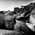Boulders and boat B&W