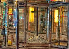 Revolving Door (Robert Lejeune) Tags: nyc newyorkcity distortion reflection glass reflections manhattan broadway timessquare 42ndstreet