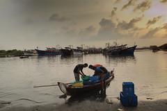 youthful endeavour (Abino Sajan) Tags: india fish beach boats dawn fishing harbour kerala hut hdr malayalam ponnani