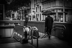 Just another rainy Sunday afternoon (Robin-Jacob) Tags: vienna wien street city bw white black monochrome rain photography austria sterreich movement samsung stadt vignetting bahn schwarz regen schirm weis strase vignettierung nx300