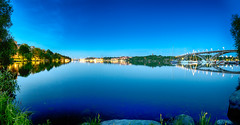 Stockholm by night (.craig) Tags: city bridge trees light panorama reflection water night reflections landscape boats lights boat dock cityscape stockholm harbour pano symmetry midnight hdr waterscape