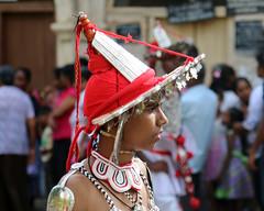 Perahera Portraits (IMG_3698b) (Dennis Candy) Tags: street boy red portrait heritage festival youth costume day profile young culture buddhism dancer parade celebration srilanka ceylon procession tradition serendipity pageant hinduism kandy headgear perahera serendib serendip esala