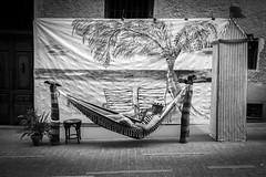 Summer retreat (carlosromonbanogon) Tags: madrid street sea summer people white black beach hat spain pipe hammock fujifilm amateur barrio letras xt1