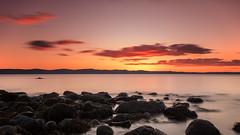 Into the Living Sea of Waking Dreams (johnkaysleftleg) Tags: drumadoonpoint kintyre arran isleofarran scotland seascape 10stopfilter nd3 ndhardgrad06 rocks shoreline sunset evening