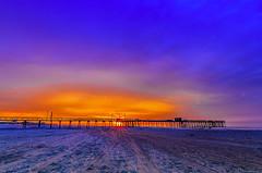 Fire In The Sky (Joe Barrett Photography) Tags: sky beach sunrise catchycolors landscape pier newjersey vibrant nj wideangle jerseyshore avalon southjersey catchycolorsblue catchycolorspurple catchycolorsorange capemaycounty flickrsbest bestoftoday yourbestoftoday tokina1120mmf28atxpro